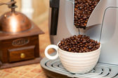 Cup of coffee grains — Stock Photo