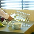 The waiter pours wine into glasses — Stok fotoğraf