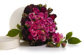 Box with bouquet of red roses — Stock Photo
