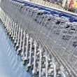 Supermarket shopping carts in a row — Foto de Stock