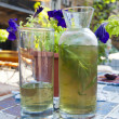 Bottle and glasses of Tarragon - Stock Photo
