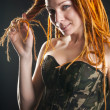 Beautiful woman posing in military corset — Stock Photo