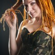 Beautiful woman posing in military corset - Stock Photo