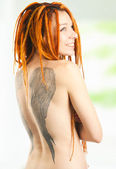 Portrait of woman with tattoo — Stockfoto