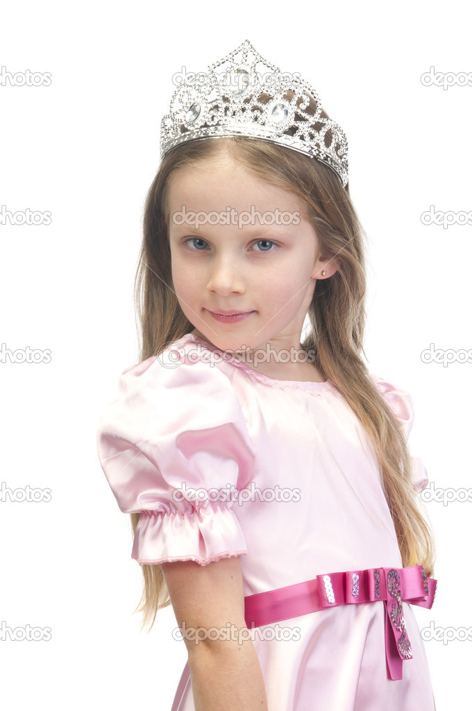 Little cute girl in pink dress with a tiara on her head  Stock Photo #16180433