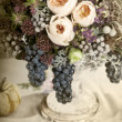 Table setting with flowers decoration — Stock Photo #16898695