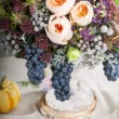 Table setting with flowers decoration - Stock Photo