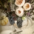 Table setting with flowers decoration — Stock Photo