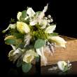 Bouquet in wooden box - Stock Photo