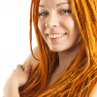 Beautiful girl with red dreadlocks - Stock Photo