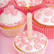 Pink muffins with candle — Stock Photo
