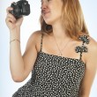 Pregnant woman with photo camera - Stockfoto