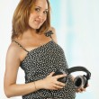 Stock Photo: Pregnant woman with headphones