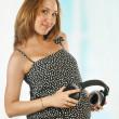 Pregnant woman with headphones — Stock Photo
