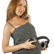 Pregnant woman with headphones — Stock Photo #17009301