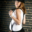 Pregnant woman with suspenders and hat — Stok fotoğraf