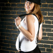 Pregnant woman with suspenders and hat — Стоковая фотография