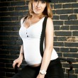 Pregnant woman with suspenders and hat - Stock Photo