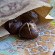 Roasted chestnuts on the map of Lvov, Ukraine - Stock Photo