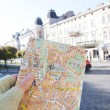 Stock Photo: Map of Lviv in girl hand, Lviv, Ukraine