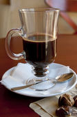 Black coffee in the glass — Stock Photo