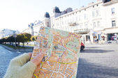 Map of Lviv in a girl hand, Lviv, Ukraine — Stock Photo