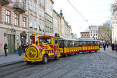 Tourist tram, Rynok square, Lvov — Stock Photo
