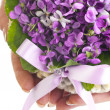 Wedding violet bouquet in the hands of a bride - Stock Photo