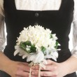Bride holding wedding flower bouquet - ストック写真