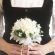 Stok fotoğraf: Bride holding wedding flower bouquet