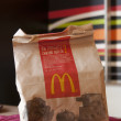 KIEV, UKRAINE, MAY 2:Macdonalds menu in a paper bag, on May 2, 2012, Kiev, ukraine — Stock Photo