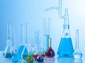 Glass laboratory equipment with colored liquid — Stock Photo