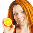 Beautiful girl with red dreadlocks holding orange — Stock Photo