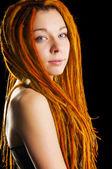 Beautiful girl with red dreadlocks — Stock Photo