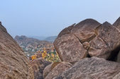 View of the Hampi behind the stones — Stock Photo