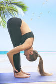Woman in uttanasana yoga pose — Stock Photo