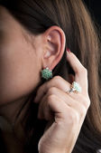 Earrings and ring with emerald — Stock Photo