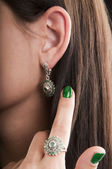 Silver earrings and ring with emerald — Stock Photo