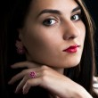 Young woman with silver ruby ring and earrings — Stock Photo #24215853