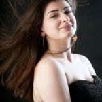 Sensual and beautiful woman in a black dress — Stock Photo #24218163