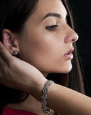 Woman with silver bracelet and earrings — Stock Photo