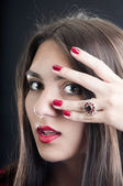 Young woman with silver garnets ring — Stock Photo