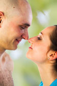 Happy couple rubbing noses — Stock Photo