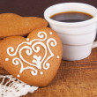 Cookies in form of heart with cup of coffee — Stock Photo #26687473
