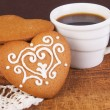 Cookies in form of heart with cup of coffee — Stock Photo
