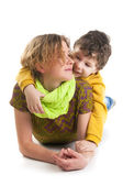 Mother and her son lying on a floor — Stock Photo