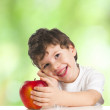 Stock Photo: Little smiling boy with red apple