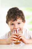 Little boy drinking juice — Foto de Stock