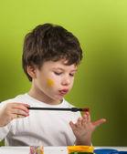 Boy painting with brush — Stock Photo