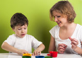 Happy mother and son painting — Stock Photo